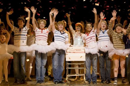 The Billys with a cake to celebrate 1000 shows in London.  The boys l-r Olly Taylor, Corey Snide, Dean McCarthy, Layton Williams and Sam Angell