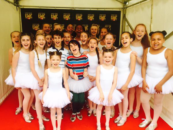 Ollie Jochim (Billy), Todd Bell (Michael) and two casts of Ballet Girls at West End Live 2015