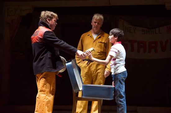 Tony (Kevin Wathen) Gives Billy (Ali Rasul) A Miner's Lamp as Dad (Deka Warmsley) Looks On
