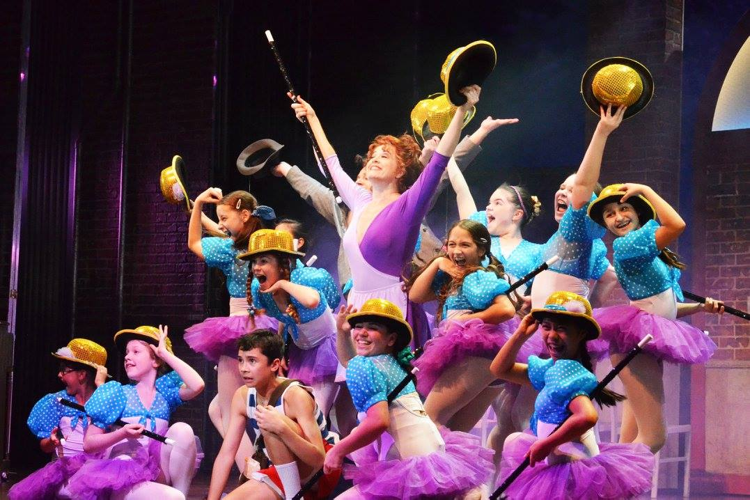 Broadway's Leslie Becker, center, stars as ballet teacher Mrs. Wilkinson and is surrounded by her ballet students and Billy (portrayed by Nicholas Dantes, front). Photo by Jen Vasbinder.
