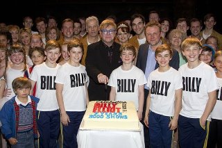 Elton John with cast and crew About to Enjoy the Cake