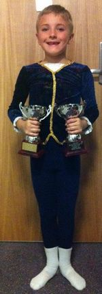 Thomas With Some of his Dance Awards