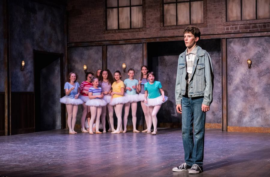 Billy (Seamus Whyte) and the Ballet Girls