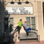 Eli and Corban outside theatre